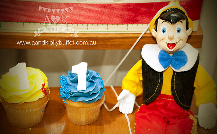 Alessandro's vintage rustic Pinocchio themed 1st birthday party dessert table by A&K Lolly Buffet