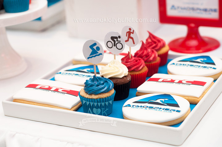 """Life is Sweet. Enjoy your hard earned treats!"". Red & Blue Triathlon themed desserts by Sweet Treats by Martie. Cupcake toppers, Styling, Artwork, Props & Photography by A&K."