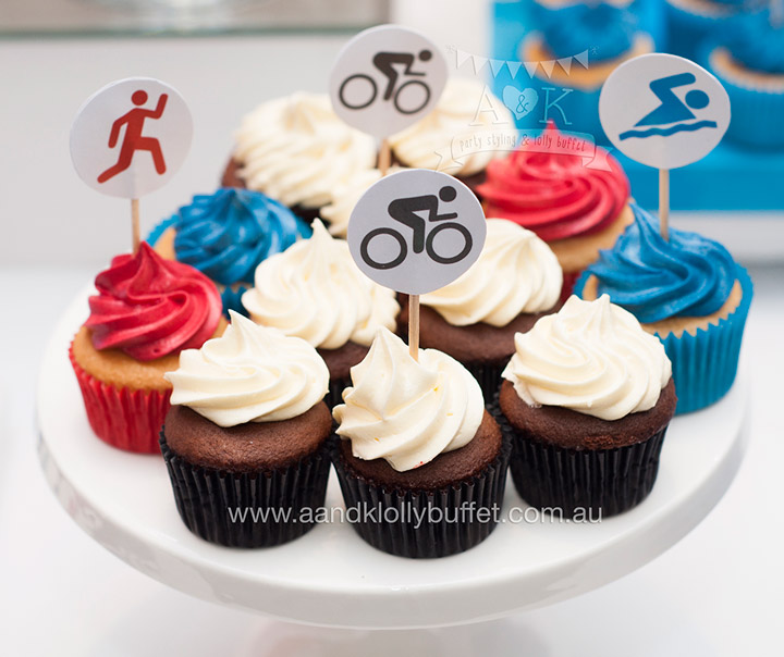 Red & Blue Triathlon themed dessert table for PTC Anniversary Ball by A&K Lolly Buffet.