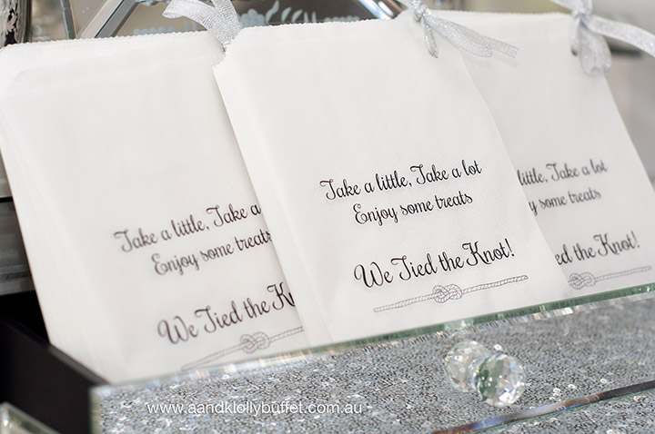 Gemma & Micheal's Elegant Silver & White Wedding dessert table by A&K Lolly Buffet